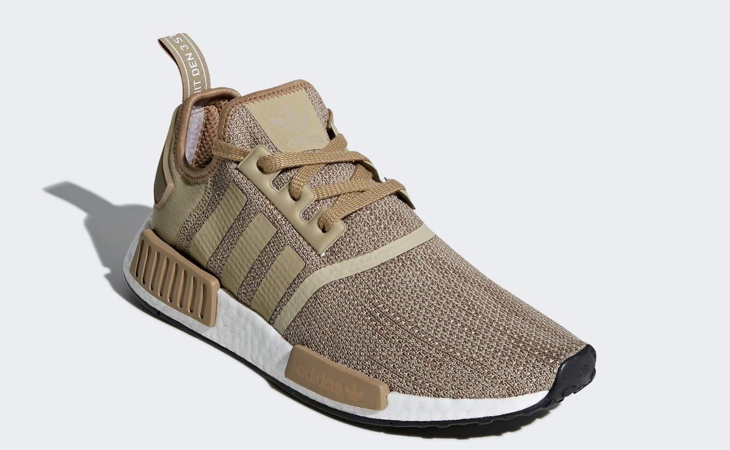 """be2ffeb996df adidas NMD R1 """"Raw Gold"""" Color  Raw Gold Cardboard Ftwr White Price   130.  Release Date  2018 (TBD)"""