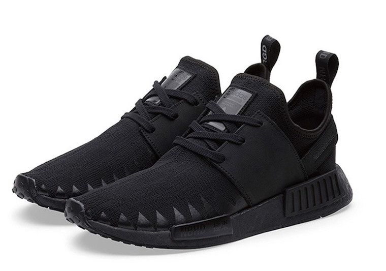 Originally only consisting of four shoes, another NMD_R1 Primeknit has  surfaced in a limited all-black colorway.