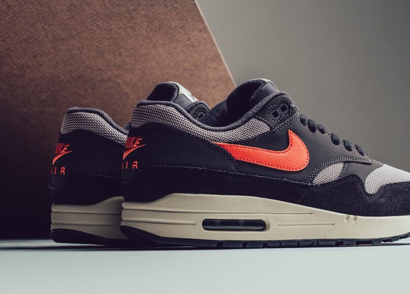 "wholesale dealer 092f9 cf7f1 The post Nike s Air Max 1 Anniversary Arrives in Stores In a New ""Wild  Mango"" Colorway appeared first on JustFreshKicks."
