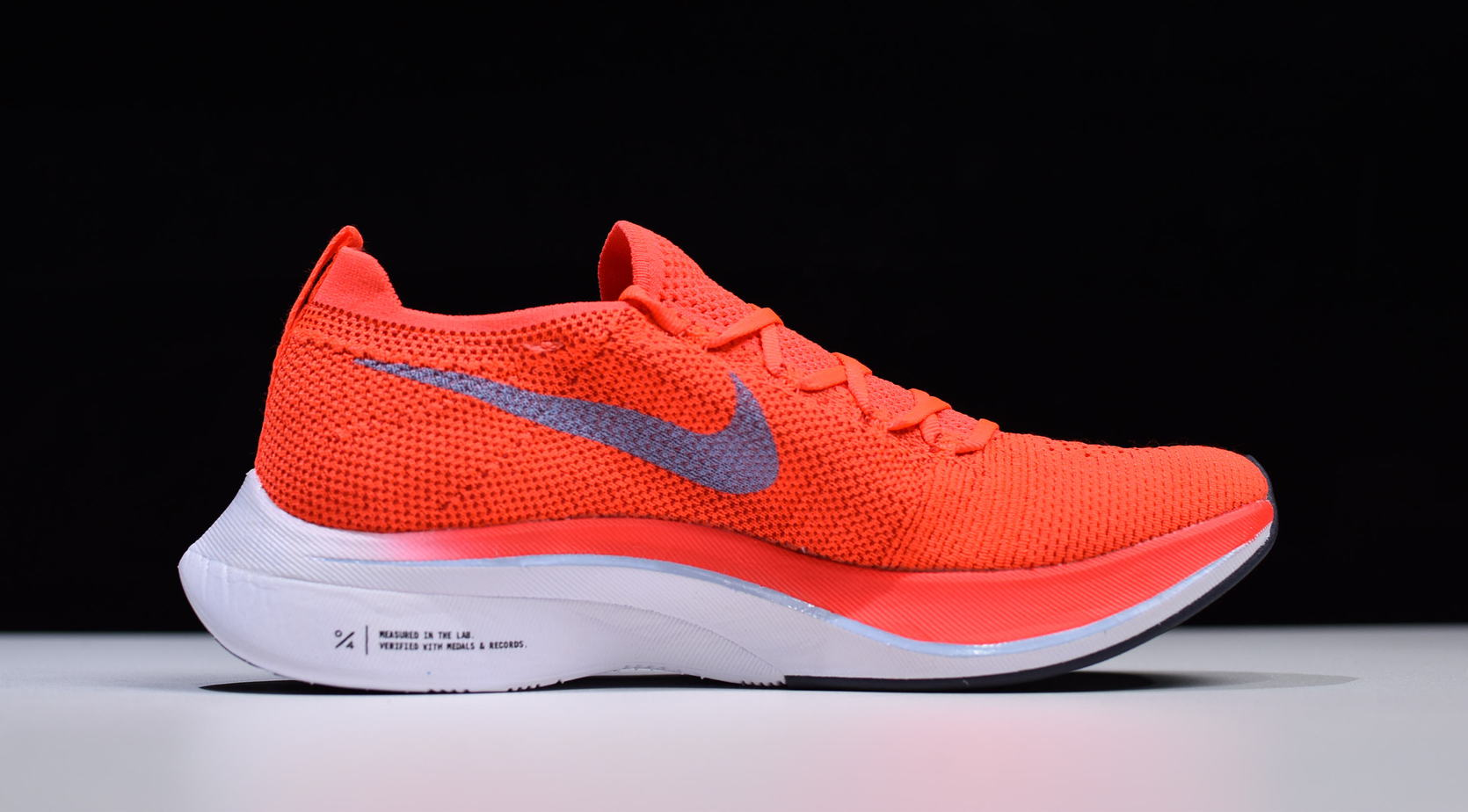 a2ff02f6fc322 Release Date Details. Nike Zoom VaporFly 4% Flyknit Color  Bright Crimson Ice  Blue ...