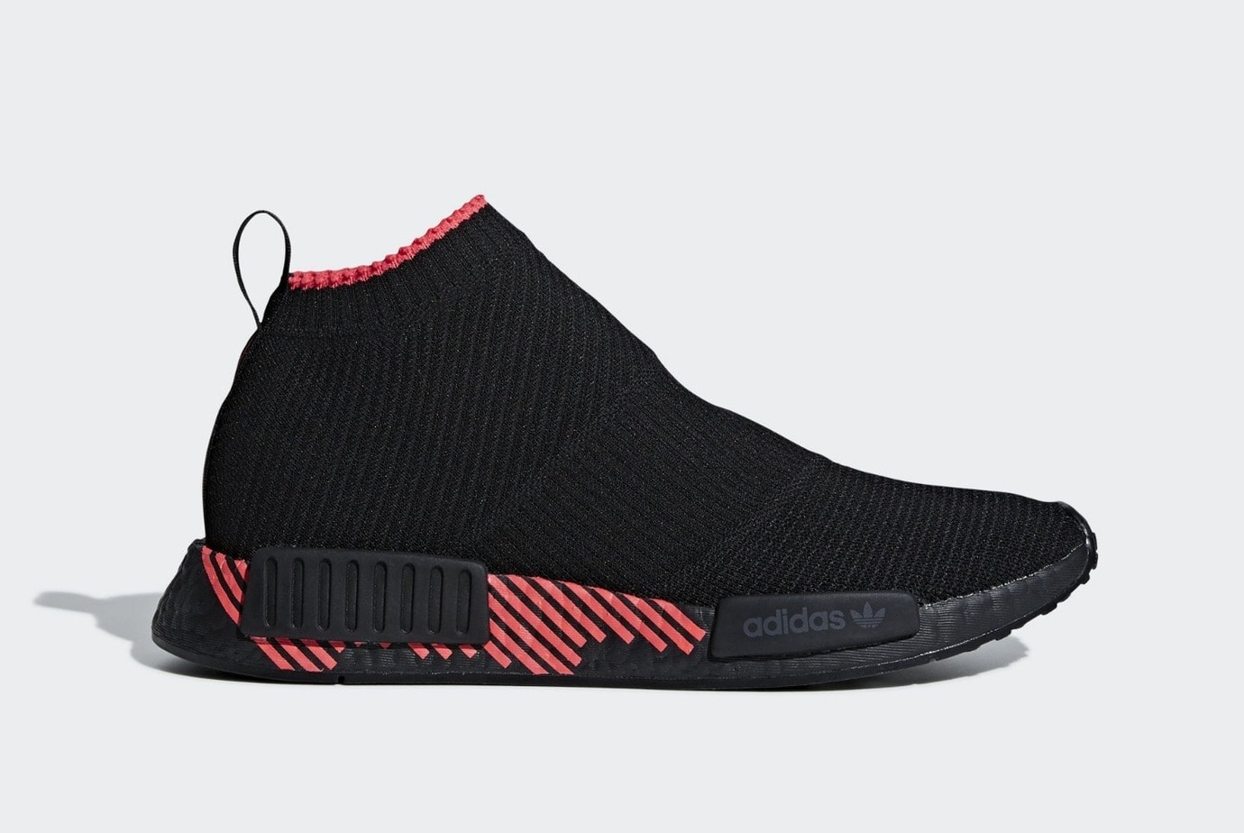 8f0590d6d701d The adidas NMD City Sock 1 Returns in All Black With a Bold Red Twist